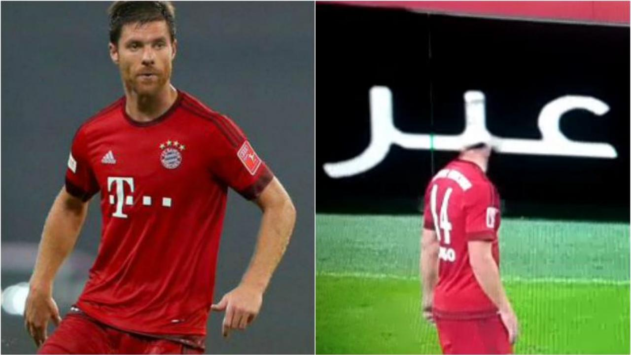Xabi Alsonso appears to disappear as his head passes in front of the sideline adds on the pitch.