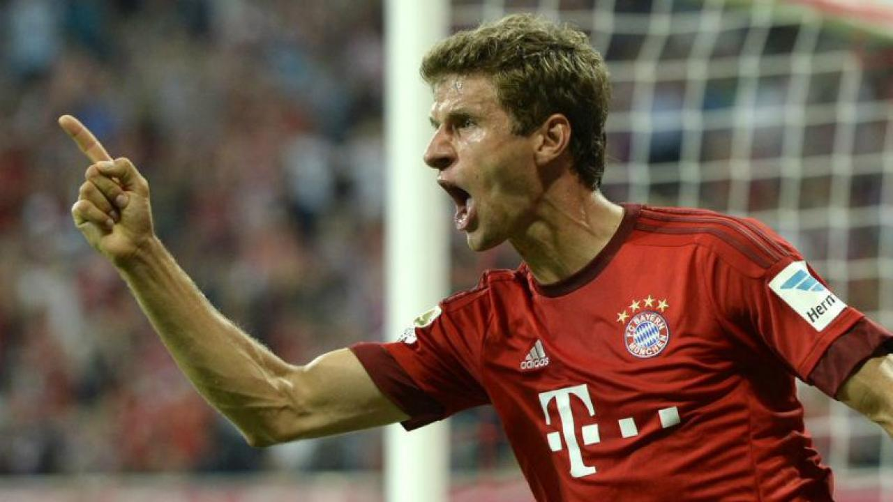 Thomas Muller poitning and yelling in the most Muller way.