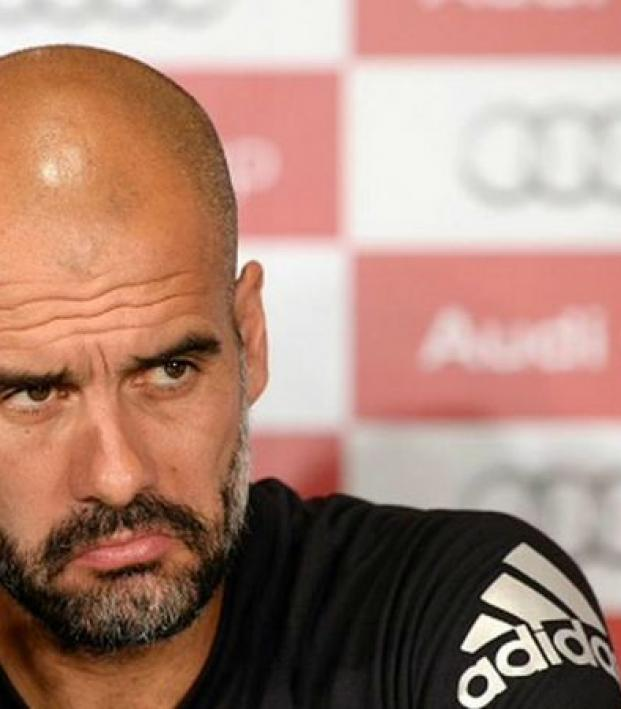 It's Guardiola at a press conference, and he looks pissed.