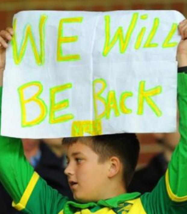 Norwich fan holds up sign in hopes of being promoted