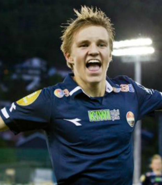 Martin Odegaard, shown celebrating a goal, is being courted by Europe's top teams including Manchester United, Bayern Munich, and FC Barcelona