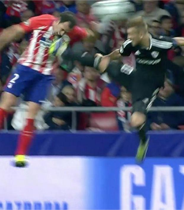 Diego Godin kicked in the face