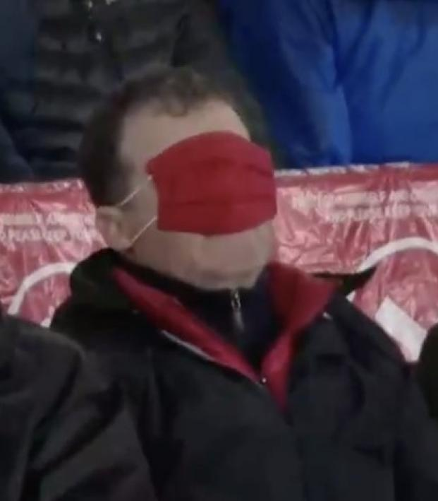 Arsenal supporter with mask