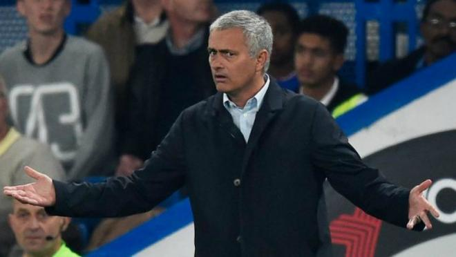 Jose Mourinho with his arms raised in accusatory confusion.