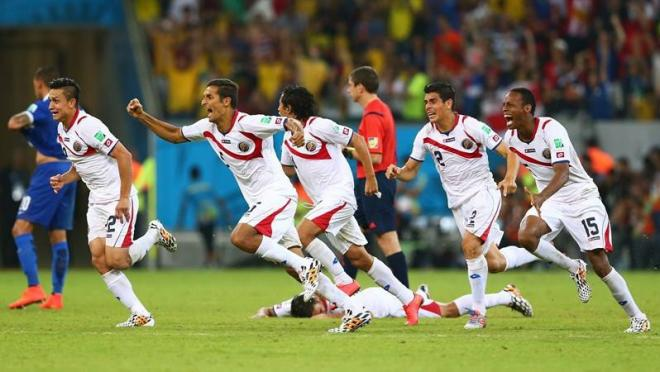 The Costa Rican soccer team celebrates their advancement on penalty kicks.