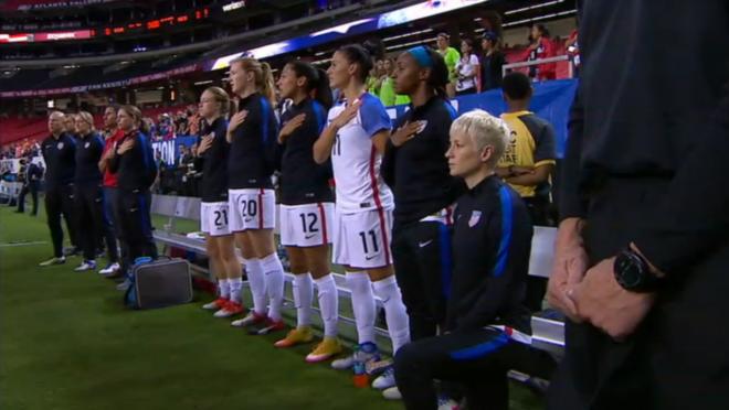 Megan Rapinoe kneels during the anthem.