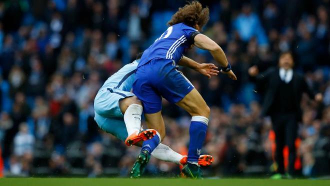 David Luiz responds to Sergio Aguero's tackle.