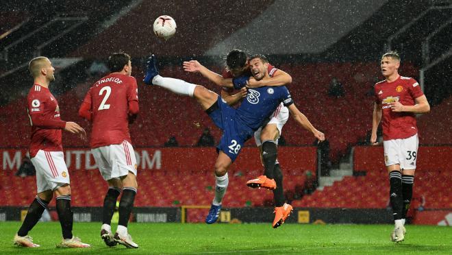 Harry Maguire headlocks Cesar Azpilicueta