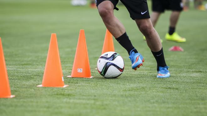 How do soccer players train