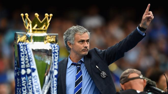 Jose Mourinho with the 2014-2015 Premier League trophy