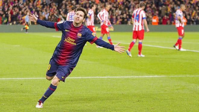 Barcelona's Lionel Messi celebrates a goal against Atletico Madrid in prior action