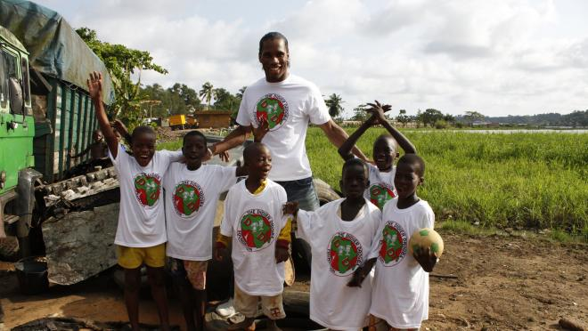 Didier Drogba helping the Ivory Coast