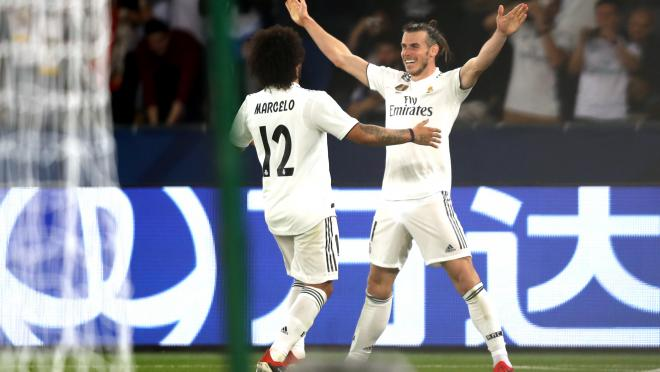 Marcelo and Bale embrace after a Madrid Goal