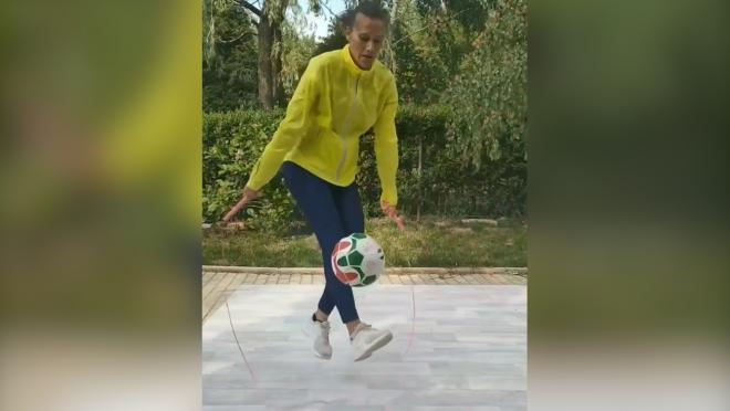 Woman jumping rope while juggling