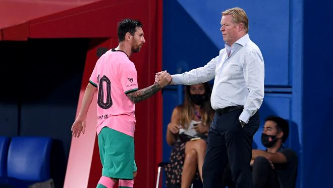 Messi shakes hands with Barcelona manager Ronald Koeman