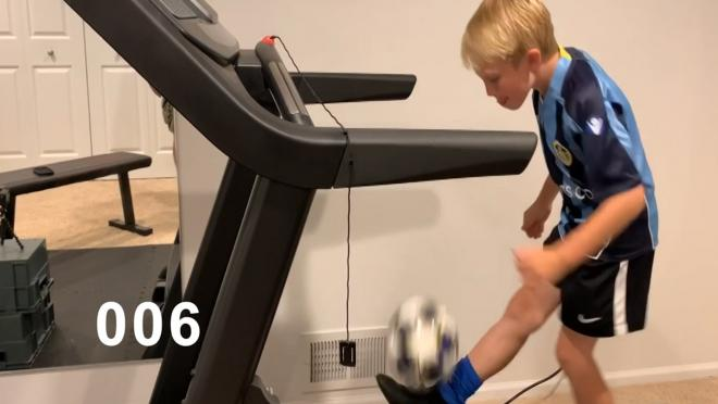 Kid practices soccer on treadmill
