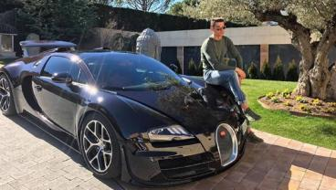 Feast Your Eyes On Cristiano Ronaldo Sitting On A Bugatti Veyron