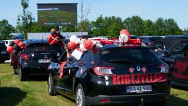 Danish Fans Enjoy Drive-In Theater Experience Outside Football Stadiums