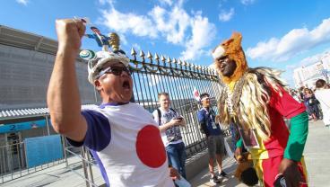 Japan And Senegal Fans Pick Up Trash After Match