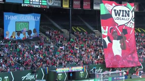 A cheering crowd with tifos, like the one that will await Kansas City FC and Seattle Reign FC in the 2015 NWSL Final at Providence Park