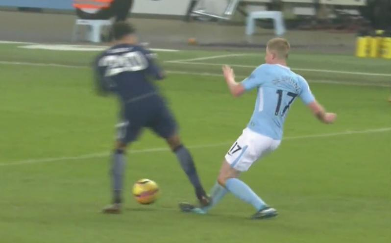 Kevin De Bruyne takes a stomp on the ankle from Dele Alli